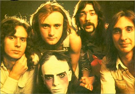 Early 70's Classic Genesis Lineup. From Left to Right: Banks, Collins (above), Gabriel (Make-up), Hackett, Rutherford